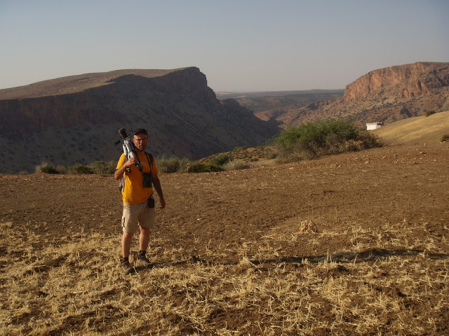 Mohamed Amezian and the rugged landscape in the background, Middle Atlas, Morocco
