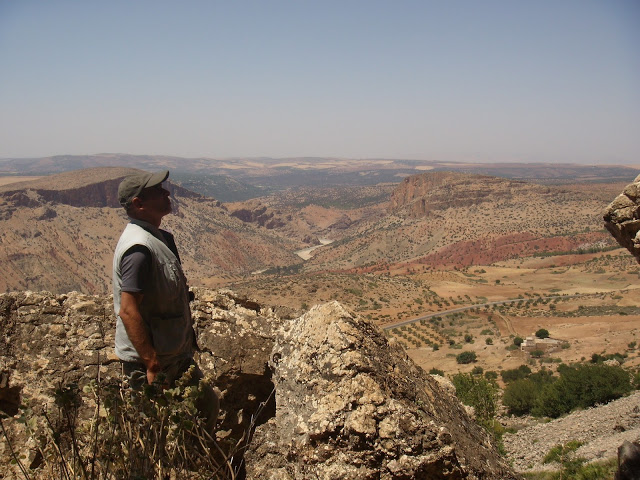 Rachid El Khamlichi in the Atlas Mountains. Note the immense rugged landscape of this part of Morocco.